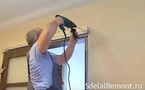 Installing sliding interior doors with their hands