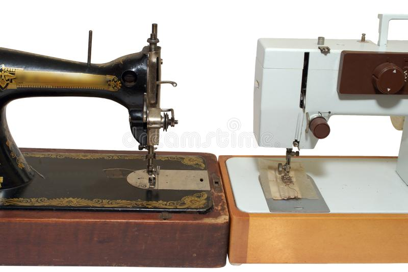 Old and new sewing machines, stand against each other. Mechanical vs electrical, vintage vs modern, concepts. isolated on white background, with clipping path stock images